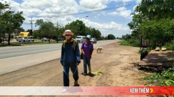Cặp vợ chồng thất nghiệp đi bộ 300 km về thăm mẹ